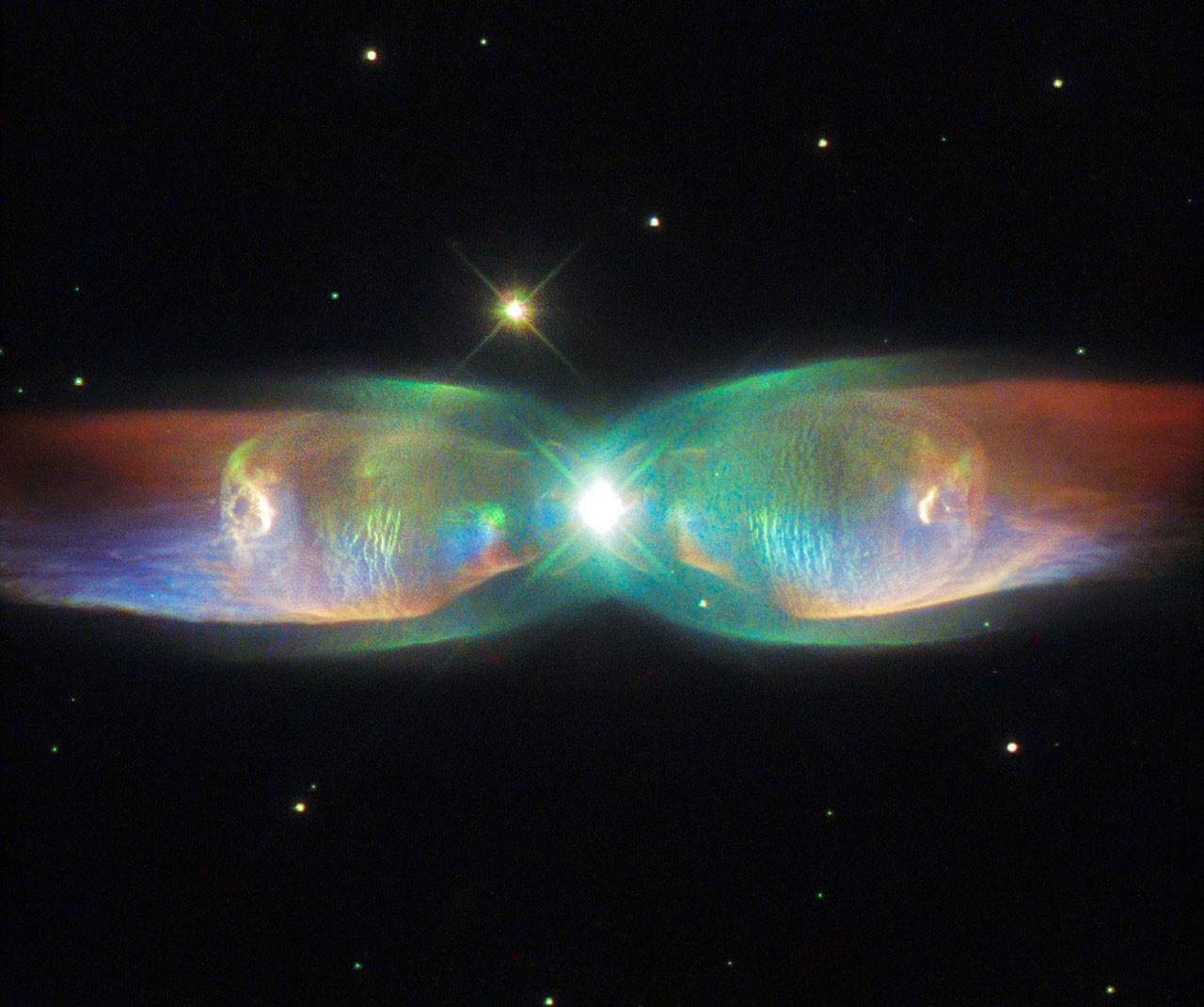 Incredible hubble space telescope image the twin jet for Nebula material