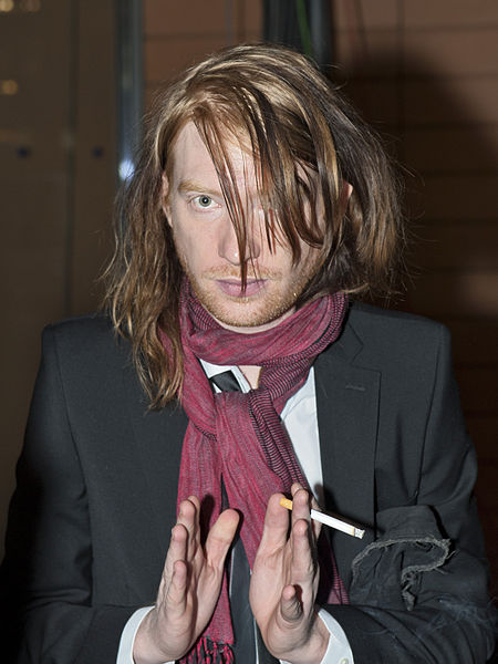 Domhnall Gleeson smoking a cigarette (or weed)